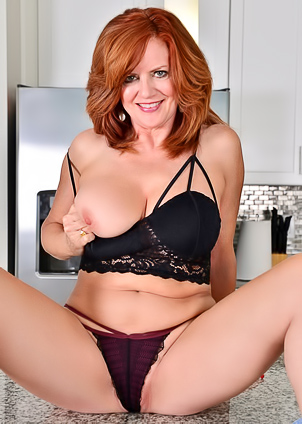 Mature business lady Andi James gets rid of her costume