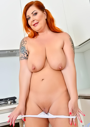 Chubby Tammy Jean performs a striptease in kitchen