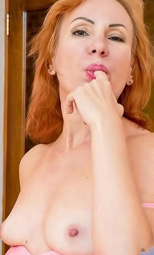 Tiny tits ginger milf Silvia strips and poses nude